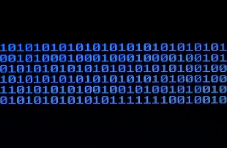Binary code on a computer monitor. Stock Photo - 13232144