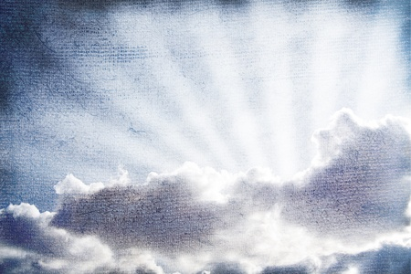 The sunbeams lighting through clouds. Old-fashioned textured effect. photo