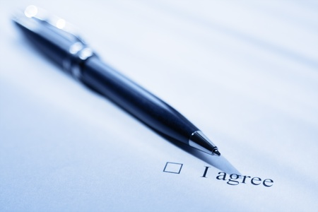 Pen and clause of an agreement. Blue color tone. photo