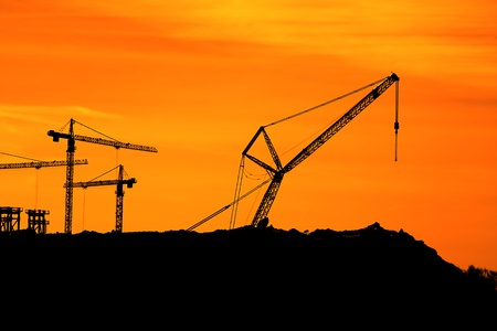 Tower Cranes on a sunset photo