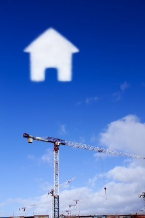 construction site in a clear day with cloud in the shape of the house photo