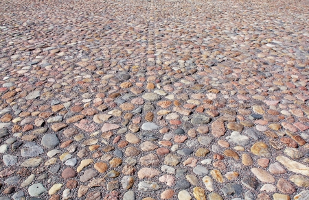 The fragment of a cobblestone pavement of a old square. photo