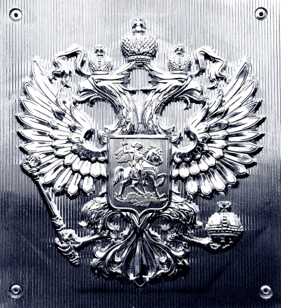 The Russian coat of arms on a metall tablet. photo