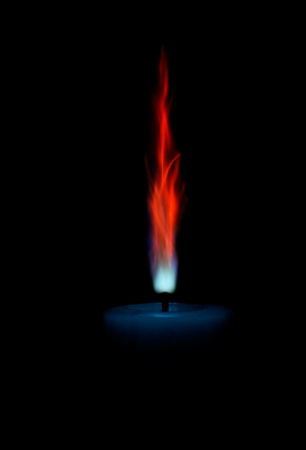 Lonely candle with unusual flame. Stock Photo - 16700811