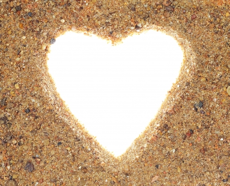 Shape of heart into a sand. It is place for your photo. photo