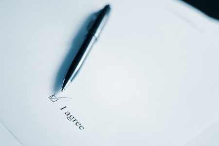 Pen and clause of an agreement. Black and white. Stock Photo - 16731492