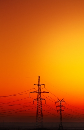 Landscape with Power Line on sunset. Stock Photo