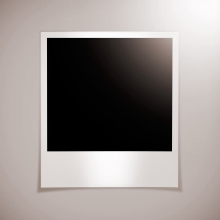 blank photo frame on a brown wall - Stock Image photo