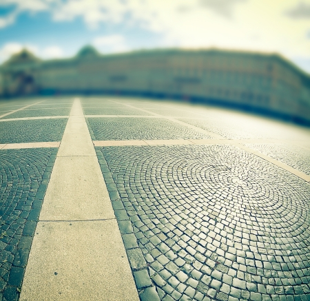 cobblestone pavement on a square with defocused background. cross-processing effect