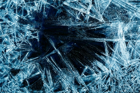 cracks in ice: the abstract background of ice structure Stock Photo