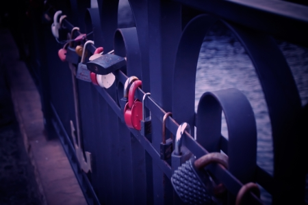 symbol of love - padlocks chained on a bridge photo