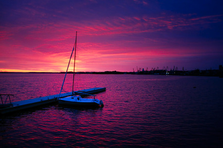 landing stage: yacht at landing stage at sunset