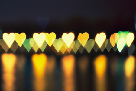 love concept - defocused lights of street lamps in the shape of hearts photo