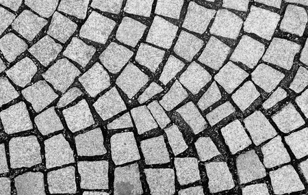 cobblestone pavement on a square, view from above, black and white photo