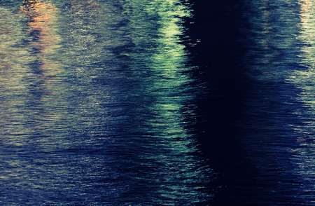 water surface of a towns river at night photo
