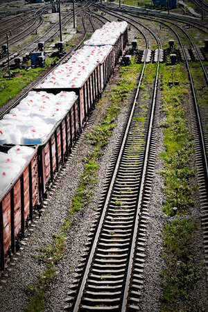 drug trafficking: white bags with drug in a wagons - abstract concept probably drug trafficking at railroad