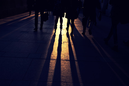 teenagers on the cobblestone pavement at sunset Stock Photo