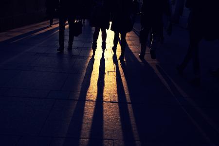 siluetas: teenagers on the cobblestone pavement at sunset Stock Photo