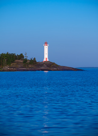 siluetas: white lighthouse at the sunrise