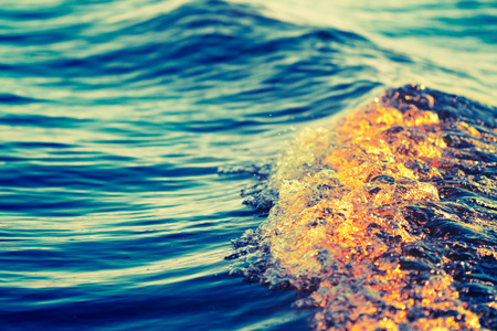low angle: sea wave close up, low angle view, cross processing effect Stock Photo