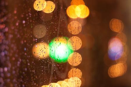 windowpane: night city life through windowpane: darkness and rain