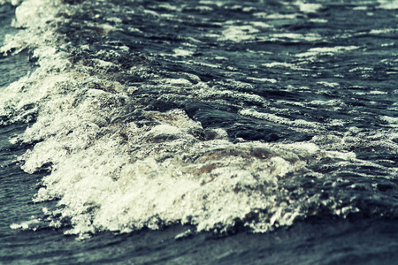 low angle view: sea wave close up, low angle view, cross processing effect Stock Photo