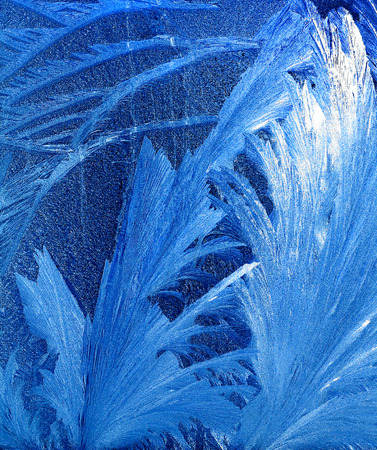 windowpane: frost pattern on a windowpane in the evening