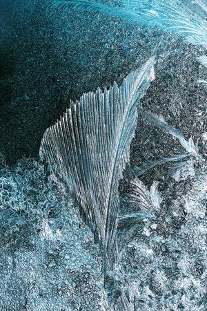 windowpane: frost pattern on a windowpane closeup