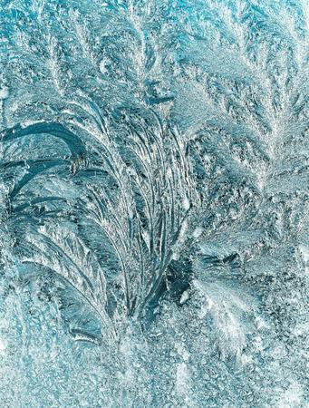 windowpane: frost pattern on a windowpane at night