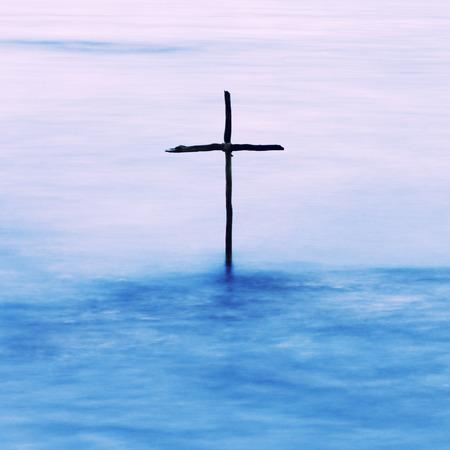 baptizing: symbol of Baptism, a wooden cross in the Jordan River