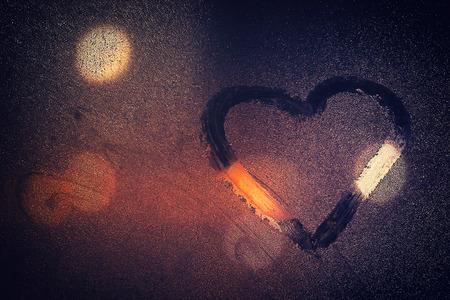 windowpane: night city life through windowpane: darkness, rain and heart