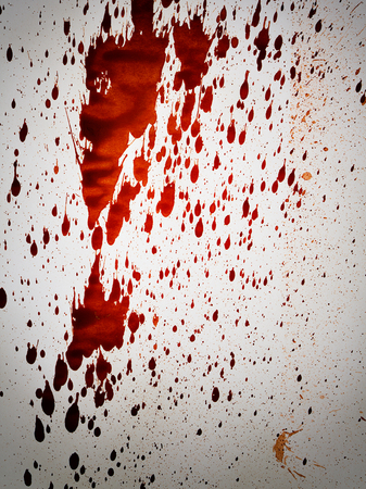 splash abstract: splashing blood drops on white