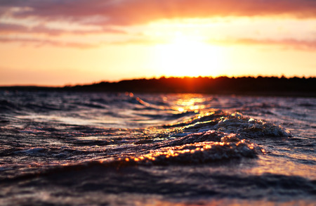 low angle view: sea wave close up at sunset, low angle view, cross processing effect Stock Photo