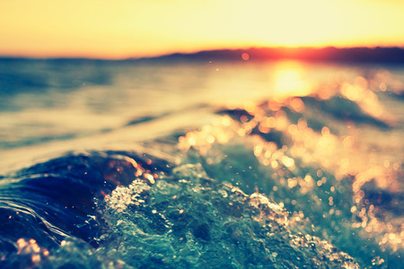 effect sunset: sea wave close up at sunset, low angle view, cross processing effect Stock Photo