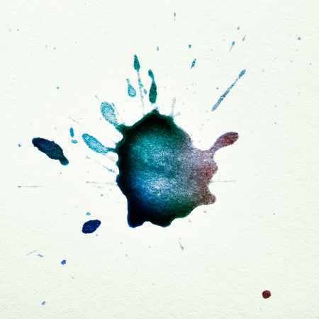 the ink blot: multicolored ink blot on a textured paper Stock Photo