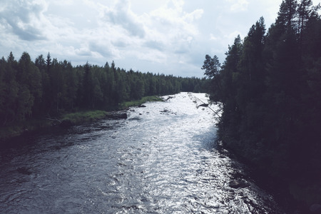 russian federation: scandinavian landscape - rapids on the river in Karelia, Russian Federation. vintage effect photo