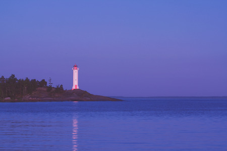 lighthouse at night in summer, Baltic sea Stock Photo