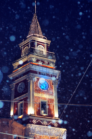 evening snowfall, Christmas and New Year time, Clock Tower of the Saint Petersburg City Duma in Russia