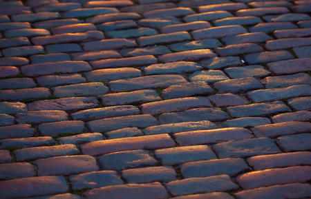 fragment of a cobblestone pavement closeup at night
