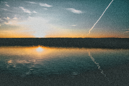 sunset on the lake, old vintage grain effect photo