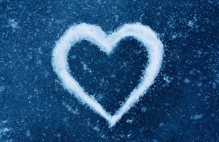 love concept, snow in the shape of heart on ice, valentine day symbol