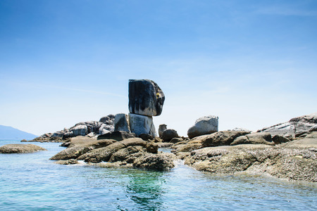 Stone overlap at koh hinson island, thailand. Perspective on a long-tail boat slowly cruising through the beautiful scenery of rocks piled nearby.