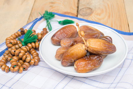 obligatory: date palm on the wood. Fasting is obligatory for adult Muslim in Ramadan. Muslim will breaking their fasting after sundown with a date palm or with water to  following the tradition.