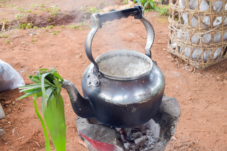 compensate: kettle used to cook rice compensate the rice cooker Stock Photo