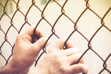 hand and steel cage on vintage tone for hope background concept