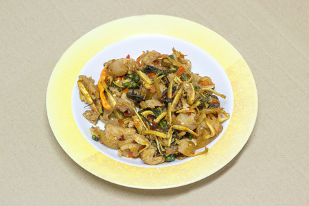 belly pepper: Stir Fried Wild Boar with Red Curry in plastic dish on card board background