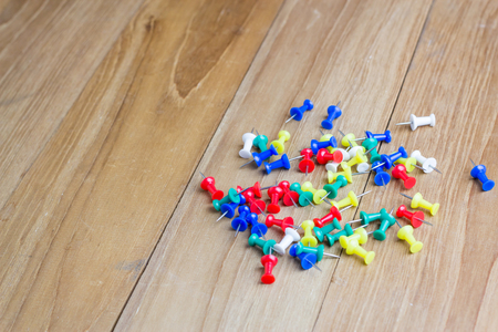 yellow tacks: colorful tack paper on wooden board Stock Photo