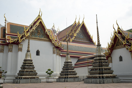 Three (3) Traditional Pagoda with Temple building at Wat Po in Bangkok, Thailand photo