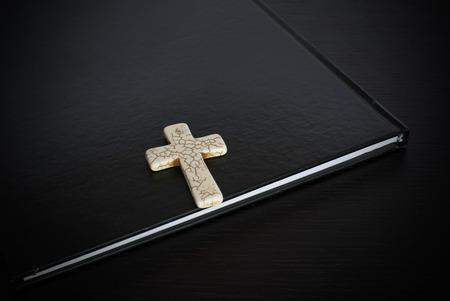 beliefs: Grunge white bone Cross on the book Easter or Christian beliefs Stock Photo