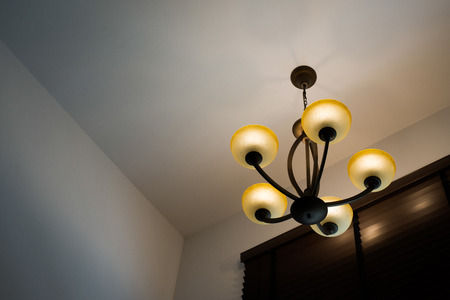 blinder: Vintage chandelier with dark wooden blinder